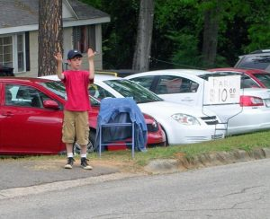 Home owners around Augusta National sell parking in their yards.