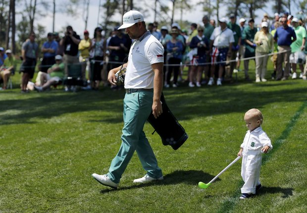 Ryan Moore with son Tucker at the 2014 Masters Par 3.